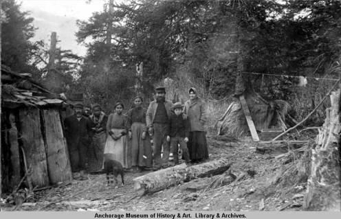 A_group_of_natives_by_a_barabara_1901_above_Seldovia