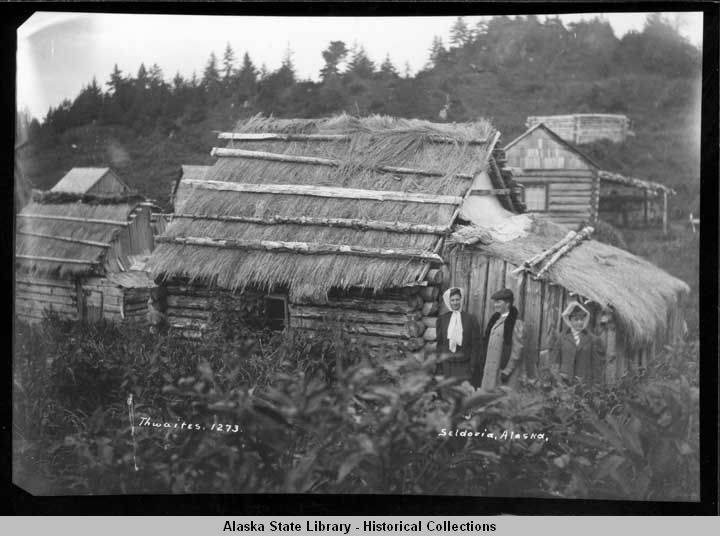 Log_cabin_with_grass_roof_in_Seldovia_Alaska