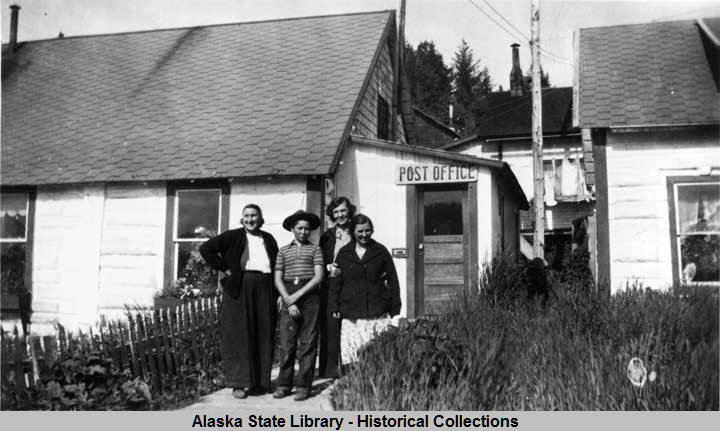 Seldovia_Alaska__Minnie_Jones_Fanny_Hayes_Jackie_Mihill_and_Goldie_standing_outside_Post_Office_Building